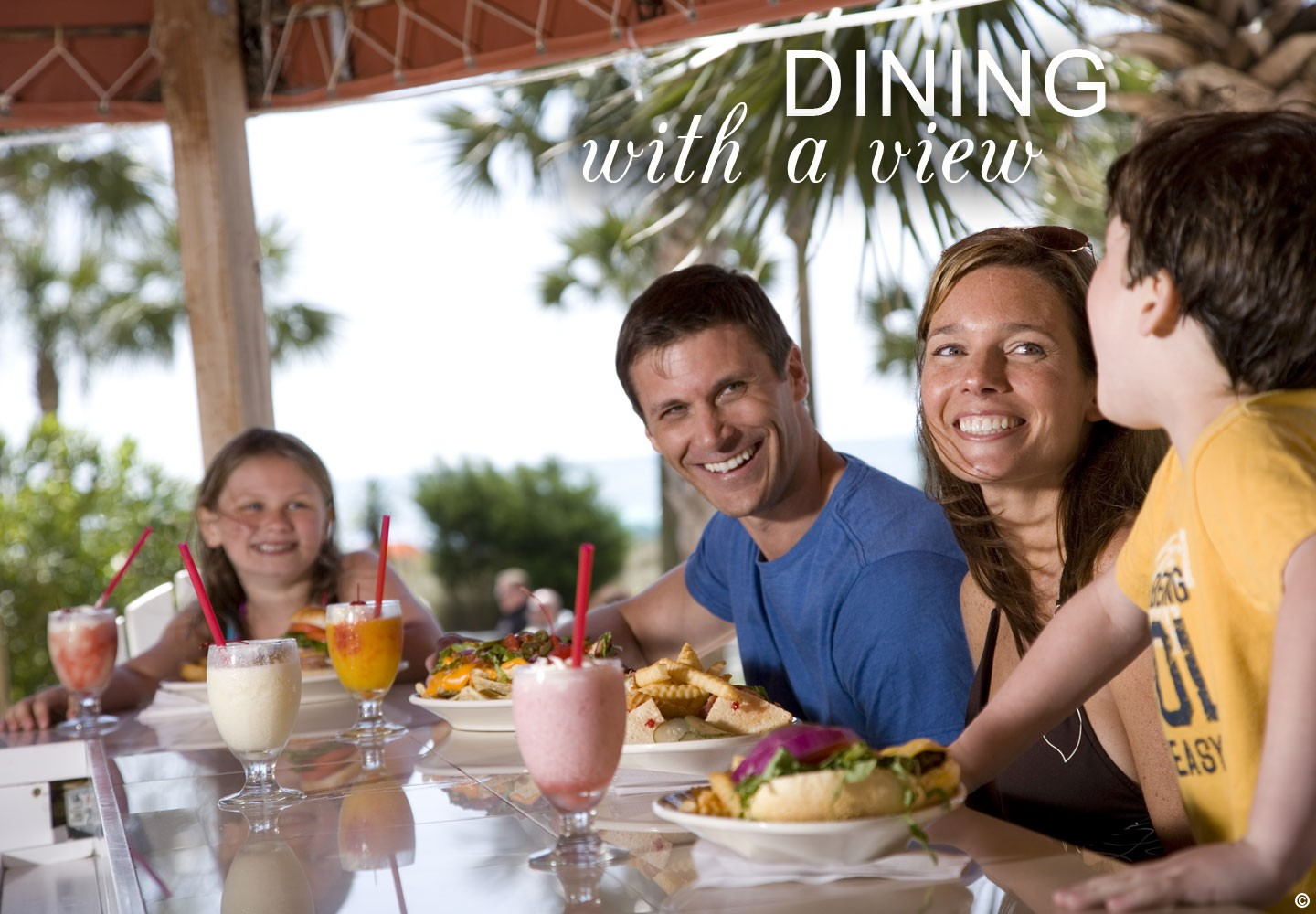 Family enjoying a meal at the on-site dining at Beach Colony Resort